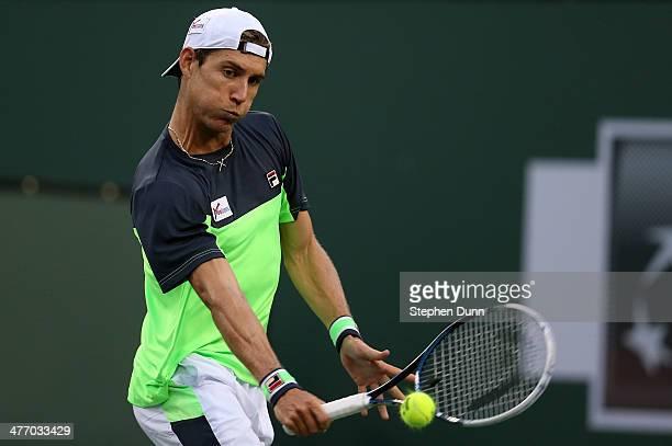 Matthew Ebden of Australia hits a return to Lleyton Hewitt of Australia during the BNP Paribas Open at Indian Wells Tennis Garden on March 6 2014 in...