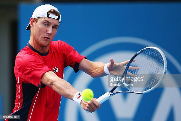 Matthew Ebden of Australia plays a backhand in his first round match against Julien Benneteau of France during day two of the Sydney International at...