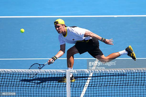 Matthew Ebden of Australia plays a forehand in his first round match against Nicolas Mahut of France during day one of the 2014 Australian Open at...