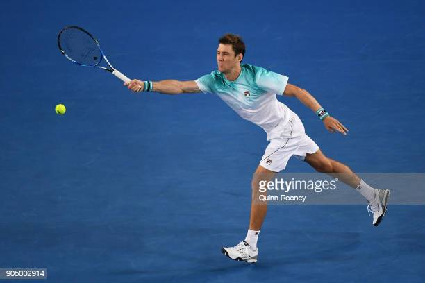 Matthew Ebden of Australia plays a forehand in his first round match against John Isner of the United States on day one of the 2018 Australian Open...