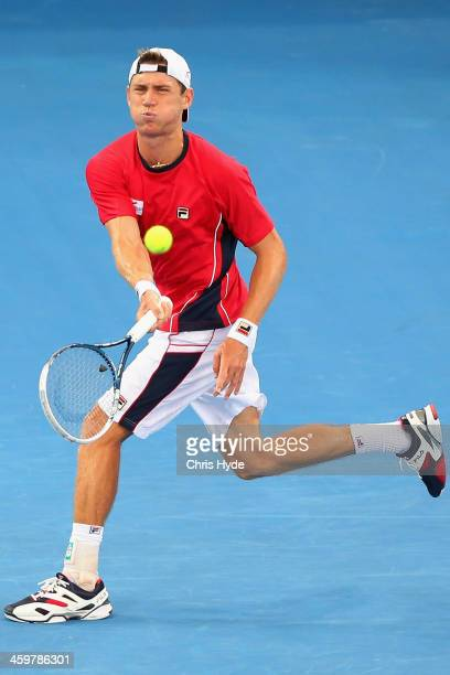 Matthew Ebden of Australia plays a forehand in his match against Alex Kuznetsov of the USA during day three of the 2014 Brisbane International at...