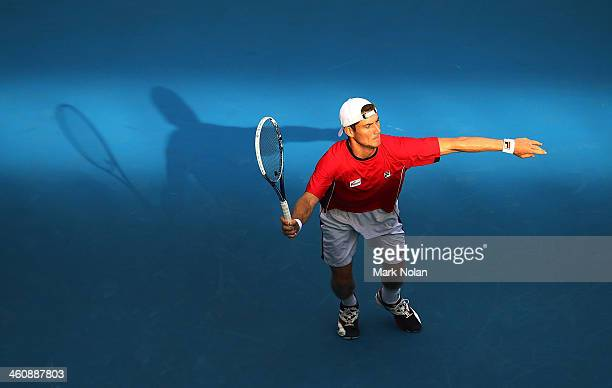 Matthew Ebden of Australia plays a forehand in his match against Julien Benneteau of France during day two of the Sydney International at Sydney...