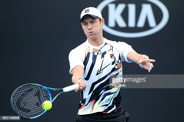 Matthew Ebden of Australia plays a shot in his second round doubles match with Matthew Barton of Australia against Pablo Carreno Busta and Guillermo...