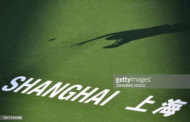 TOPSHOT Matthew Ebden of Australia serves against Frances Tiafoe of the US during their men's singles round of 64 match at the Shanghai Masters...