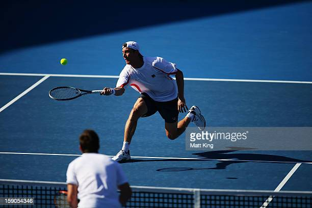 Matthew Ebden of Australia stretches out for a forehand volley in his first round match against Marcel Granollers of Spain during day two of the...