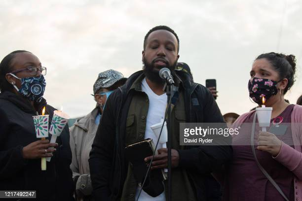 Matthew Ellis holing a Bible pauses while speaking during a vigil for his brother Manuel Ellis a black man whose March death while in Tacoma Police...