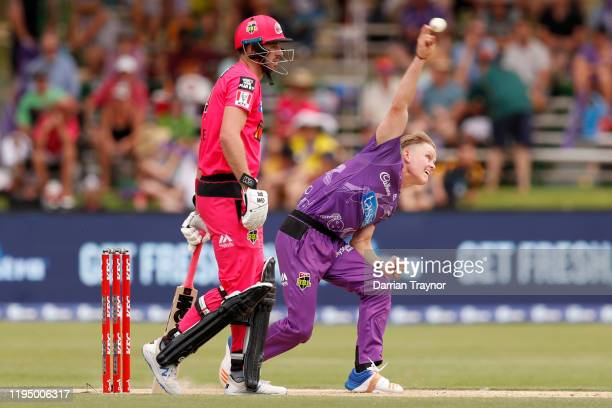 Matthew Ellis of the Hurricanes bowls during the Big Bash League match between the Hobart Hurricanes and the Sydney Sixers at Traeger Park on...