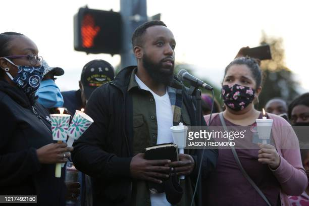 Matthew Ellis speaks at a vigil at the intersection where his brother Manuel Ellis a 33yearold black man died in Tacoma Police custody on March 3 and...