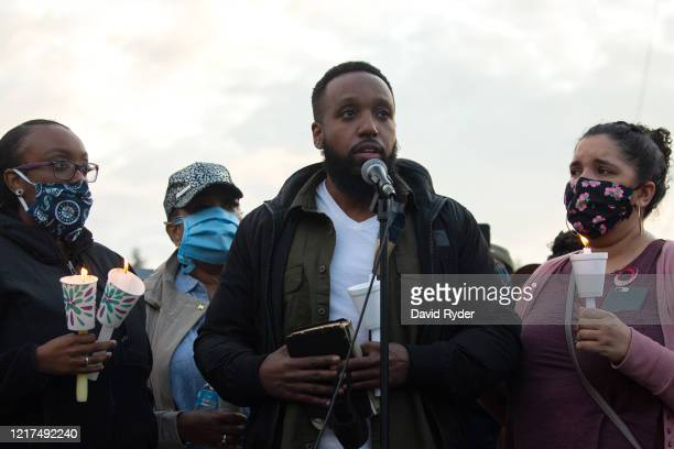 Matthew Ellis speaks while holding a Bible during a vigil for his brother Manuel Ellis a black man whose March death while in Tacoma Police custody...