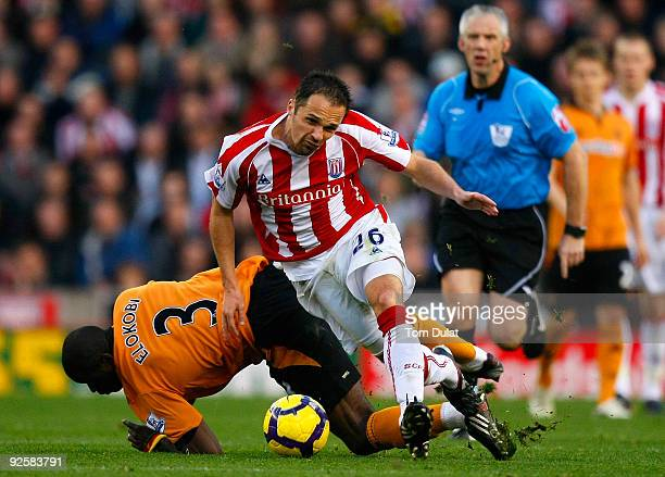 Matthew Etherington of Stoke City and George Elekobi of Wolverhampton Wanderers battle for the ball during the Barclays Premier League match between...