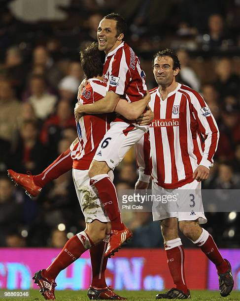 Matthew Etherington of Stoke City celebrates with Dean Whitehead and Danny Higginbotham after he scores their first goal during the Barclays Premier...