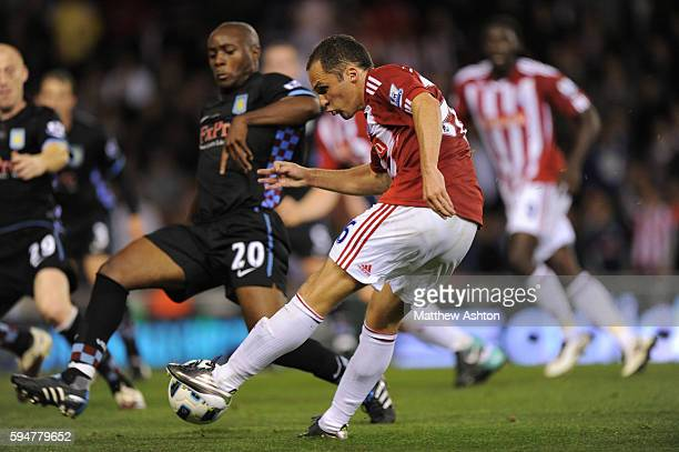 Matthew Etherington of Stoke City shoots with Nigel ReoCoker of Aston Villa defending before Robert Huth of Stoke City connected to score the winning...