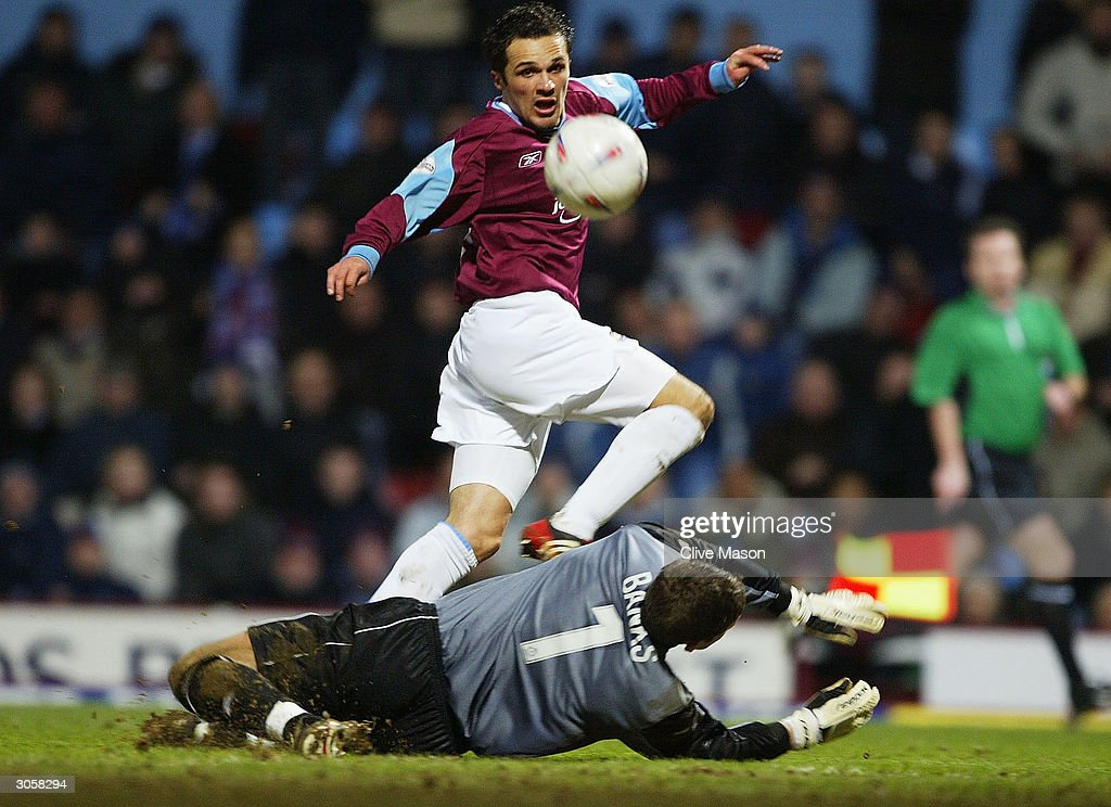 Matthew Etherington of West Ham chips the ball over Steve Banks of Wimbledon to score his hat-trick during the Nationwide Division One match between West Ham United and Wimbledon at Upton Park on March 9, 2004 in London.