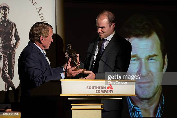 Matthew Faldo accepts the 2014 Payne Stewart award on behalf of his father Nick, who was unable to attend the ceremony at the TOUR Championship by...
