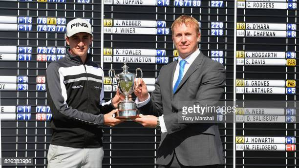 Matthew Fieldsend of Drayton Park Golf Club is presented with the PGA Assistants' Championship Trophy by Galvin Green Managing Director Greg Pearse...