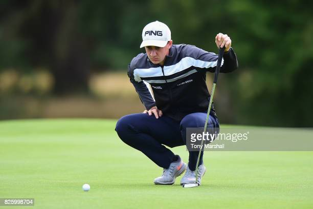 Matthew Fieldsend of Drayton Park Golf Club lines up his putt on the 18th green during Day Two of the Galvin Green PGA Assistants' Championship at...