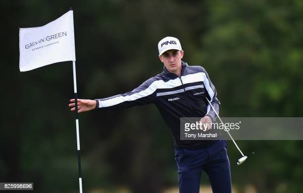 Matthew Fieldsend of Drayton Park Golf Club removes the pin flag on the 18th green during Day Two of the Galvin Green PGA Assistants' Championship at...