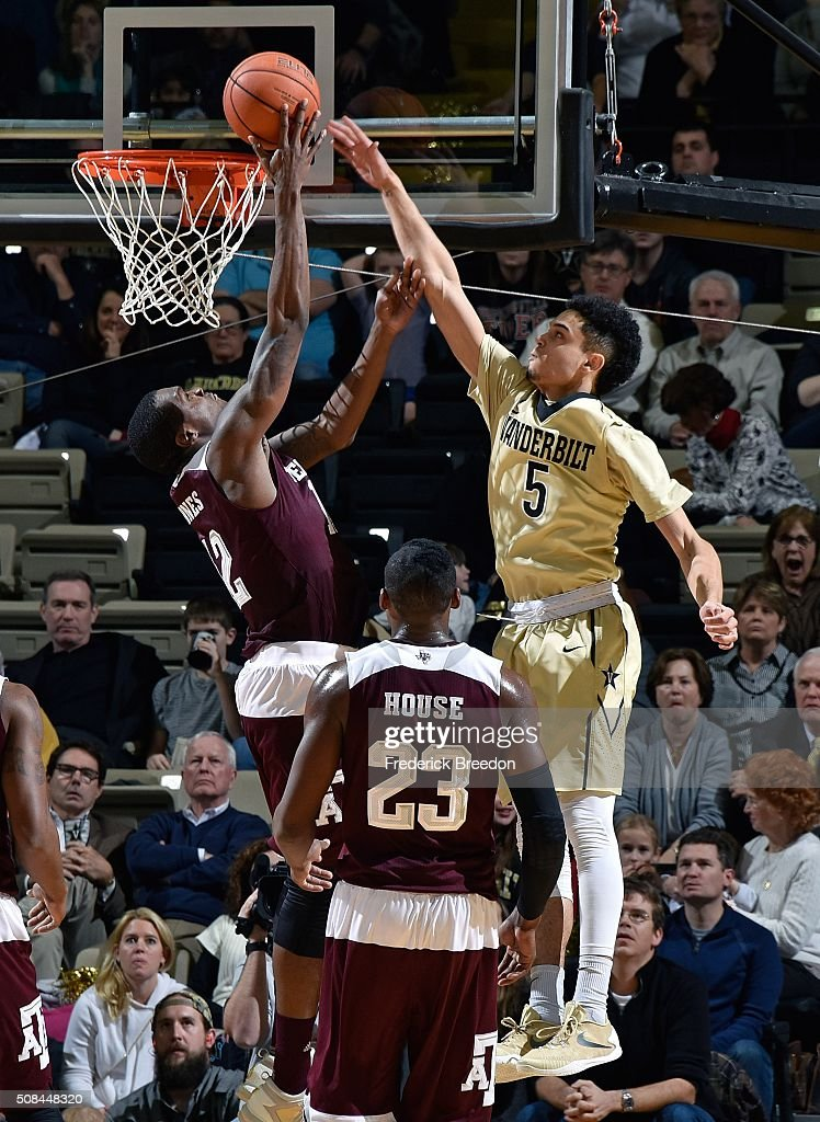 Matthew Fisher Davis #5 of the Vanderbilt Commodores jumps to block a shot by Jalen Jones #12 of the Texas A&M Aggies during the second half of a 77-60 Vanderbilt upset of Texas A&M at Memorial Gym on February 4, 2016 in Nashville, Tennessee.