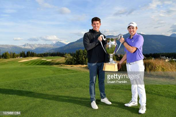 Matthew Fitzpatrick of England and his brother Alex celebrate with the trophy after winning The Omega European Masters at CranssurSierre Golf Club on...