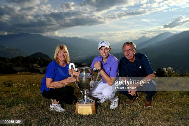 Matthew Fitzpatrick of England and his parents Russell Fitzpatrick and Susan Fitzpatrick celebrate with the trophy after winning The Omega European...