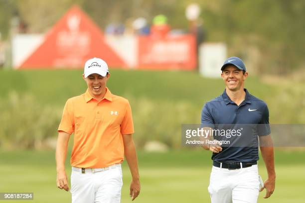Matthew Fitzpatrick of England and Rory McIlroy of Northern Ireland walk on the second hole during the final round of the Abu Dhabi HSBC Golf...