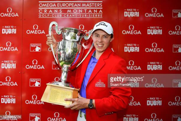 Matthew Fitzpatrick of England celebrate with the trophy after winning The Omega European Masters at CranssurSierre Golf Club on September 9 2018 in...
