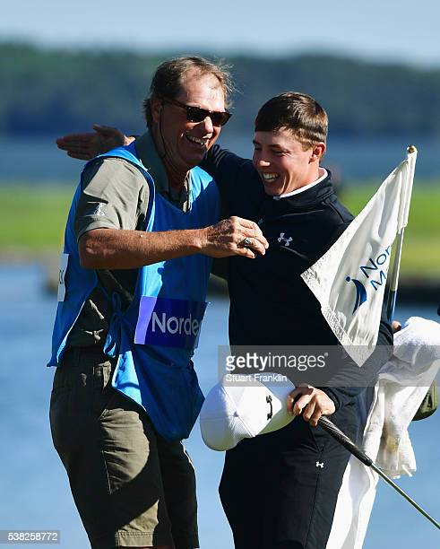 Matthew Fitzpatrick of England celebrates victory on the 18th green with caddie Lorne Duncan after the final round on day four of the Nordea Masters...