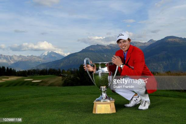 Matthew Fitzpatrick of England celebrates with the trophy after winning The Omega European Masters at CranssurSierre Golf Club on September 9 2018 in...