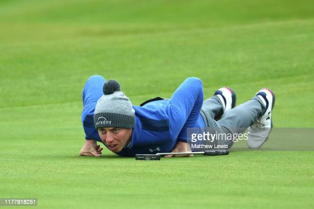 Matthew Fitzpatrick of England lines up a putt on the first hole during Day four of the Alfred Dunhill Links Championship at The Old Course on...