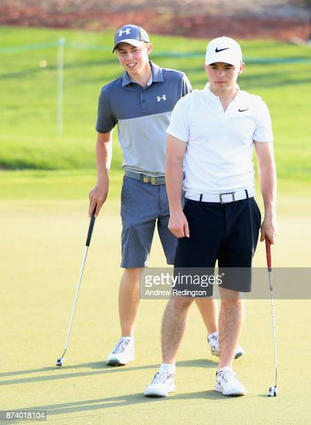 Matthew Fitzpatrick of England looks on with his brother Alex during the ProAm prior to the DP World Tour Championship at Jumeirah Golf Estates on...