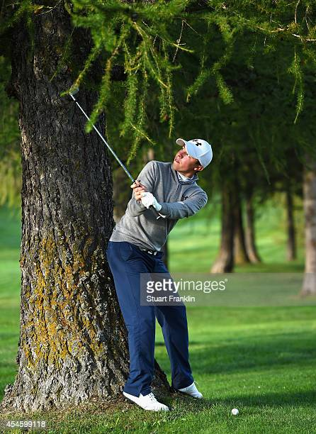 Matthew Fitzpatrick of England plays a shot during the first round of the Omega European Masters at CranssurSierre Golf Club on September 4 2014 in...