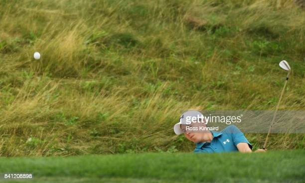 Matthew Fitzpatrick of England plays a shot from a bunker on the 13th hole during day one of the DD REAL Czech Masters at Albatross Golf Resort on...