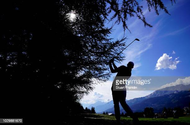 Matthew Fitzpatrick of England plays a shot on the 14th hole during the final round of the Omega European Masters at CranssurSierre Golf Club on...