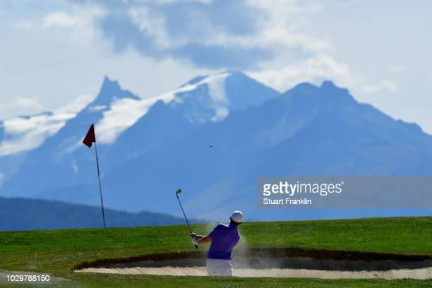 Matthew Fitzpatrick of England plays from a bunker on the 7th hole during day four of The Omega European Masters at CranssurSierre Golf Club on...