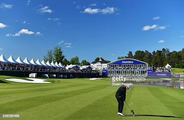 Matthew Fitzpatrick of England plays his approach shot on the 18th hole during the final round of the Nordea Masters at Bro Hof Slott Golf Club on...
