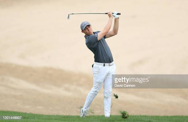 Matthew Fitzpatrick of England plays his second shot on the 14th hole during the first round of the Omega Dubai Desert Classic on the Majlis Course...