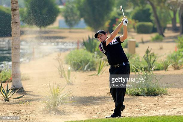 Matthew Fitzpatrick of England plays his second shot on the par 4, 9th hole during the second round of the Abu Dhabi HSBC Golf Championship at Abu...