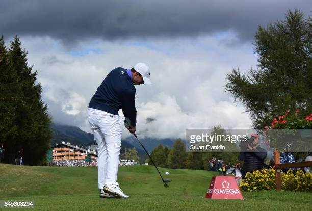 Matthew Fitzpatrick of England plays his tee shot on the 18th hole during the final round of the Omega European Masters at CranssurSierre Golf Club...