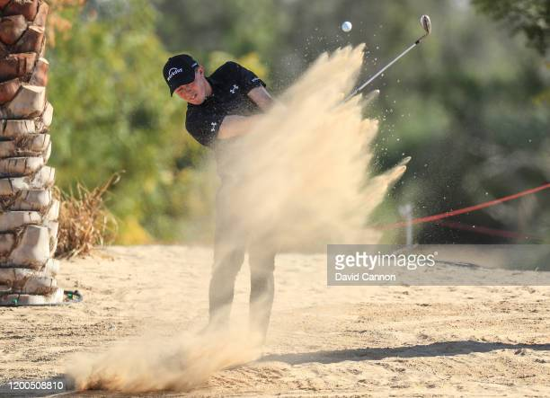 Matthew Fitzpatrick of England plays his third shot on the 10th hole during the final round of the Abu Dhabi HSBC Championship at Abu Dhabi Golf Club...