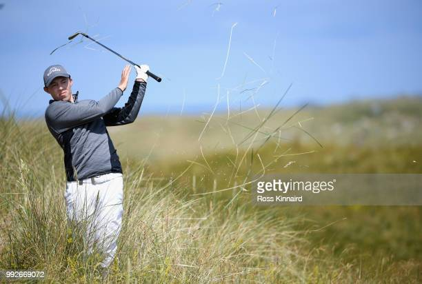 Matthew Fitzpatrick of England plays his third shot on the sixth hole during the second round of the Dubai Duty Free Irish Open at Ballyliffin Golf...