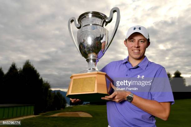 Matthew Fitzpatrick of England poses with the trophy after Day Five of the Omega European Masters at CranssurSierre Golf Club on September 10 2017 in...