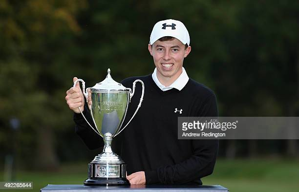 Matthew Fitzpatrick of England poses with the trophy after winning the British Masters supported by Sky Sports at Woburn Golf Club on October 11 2015...