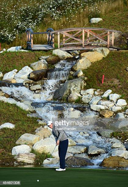 Matthew Fitzpatrick of England putts during the first round of the Omega European Masters at CranssurSierre Golf Club on September 4 2014 in...