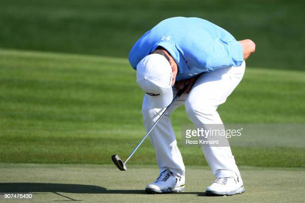 Matthew Fitzpatrick of England reacts to a mised birdie putt on the 16th green during round three of the Abu Dhabi HSBC Golf Championship at Abu...