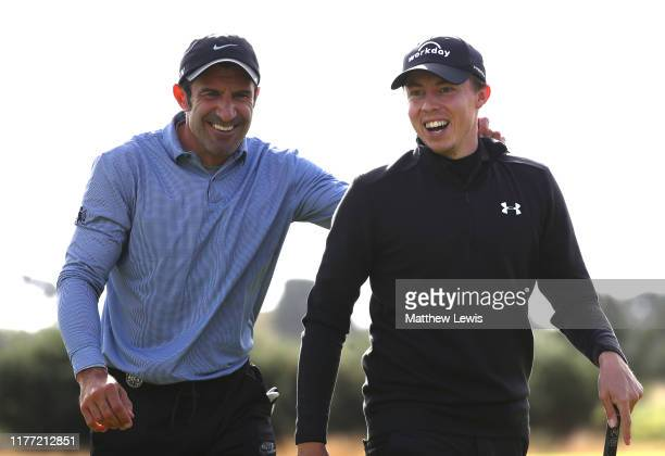 Matthew Fitzpatrick of England shares a joke with former football player Luis Figo on the 10th during Day one of the Alfred Dunhill Links...