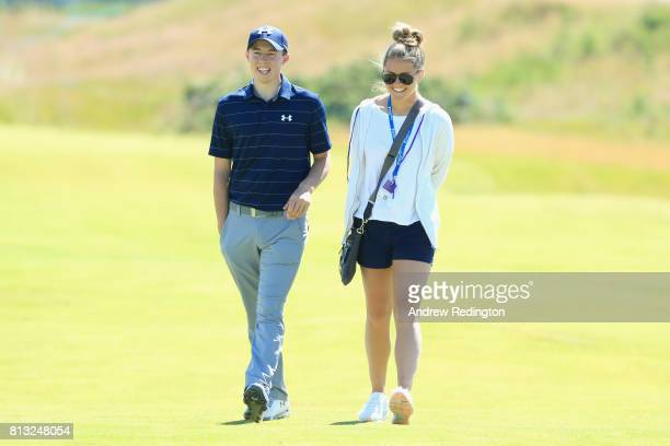 Matthew Fitzpatrick of England speaks to his girlfriend Lydia Cassada during a Pro-Am prior to the AAM Scottish Open at Dundonald Links Golf Course...