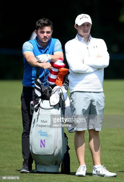 Matthew Fitzpatrick of England stands with his brother Alex Fitzpatrick on the 18th during the Pro Am for the BMW PG Championship at Wentworth on May...