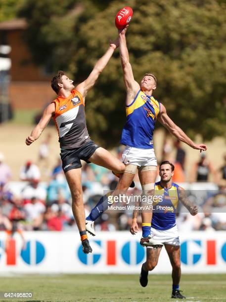 Matthew Flynn of the Giants and Nathan Vardy of the Eagles compete in a ruck contest during the AFL 2017 JLT Community Series match between the GWS...