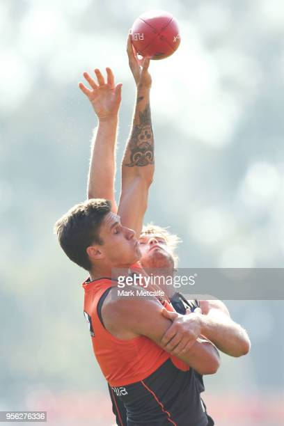 Matthew Flynn of the Giants and Rory Lobb of the Giants compete for the ball during a Greater Western Sydney Giants AFL training session at Spotless...
