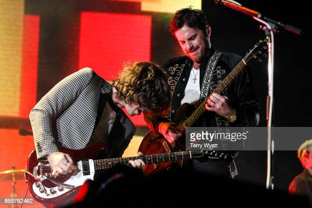 Matthew Followill and Caleb Followill of 'Kings Of Leon' perform at First Tennessee Park on September 29 2017 in Nashville Tennessee